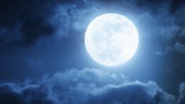 Dramatic Nighttime Clouds and Sky With Large Full Blue Moon